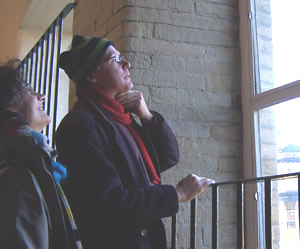 Stefan and Sabine size up one of the windows at Salts Mill.